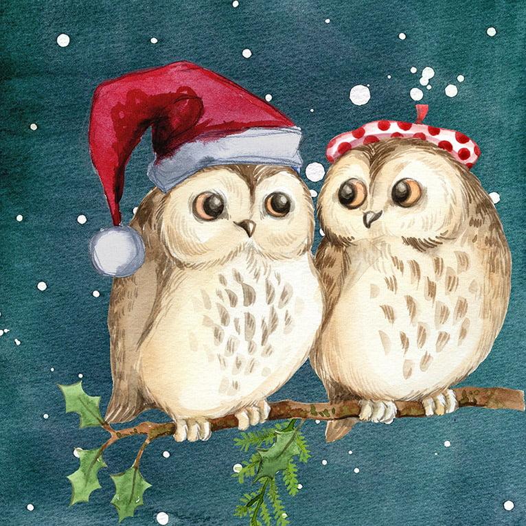 Ugglor som firar jul och sitter på ett träd